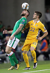 Republic of Ireland's Daryl Murphy (left) and Moldova's Artiom Rozgoniuc battle for the ball during the 2018 FIFA World Cup Qualifying, Group D match at the Aviva Stadium, Dublin.