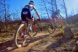 WELLINGTON SOUTH AFRICA - MARCH 23: Robyn de Groot and Sabine Spitz during stage five's 39km time trial on March 23, 2018 in Wellington, South Africa. Mountain bikers gather from around the world to compete in the 2018 ABSA Cape Epic, racing 8 days and 658km across the Western Cape with an accumulated 13 530m of climbing ascent, often referred to as the 'untamed race' the Cape Epic is said to be the toughest mountain bike event in the world. (Photo by Dino Lloyd)