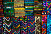 Colourful Guatemalan textiles in Panajachel, the largest settlement on the banks of Lake Atitlan. Lake Atitlan is seen as the most important single tourist attraction in Guatemala; and is Central Americas deepest lake. There are many villages on the banks of the lake; each with different identity and culture; the majority of the population in the region identify as indigenous Maya and many still wear traditional dress and speak Maya languages.