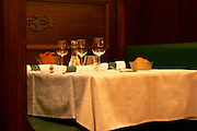 The restaurant Le Chaudron in Tournon: a table set with linen table cloth and wine glasses, napkins knives forks Tournon-sur-Rhone, Ardeche Ardèche, France, Europe