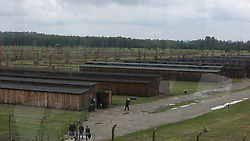 Barracks at the Auschwitz-Birkenau Nazi concentration camps in Auschwitz, Poland on September 3, 2017. Auschwitz concentration camp was a network of German Nazi concentration camps and extermination camps built and operated by the Third Reich in Polish areas annexed by Nazi Germany during WWII. It consisted of Auschwitz I (the original camp), Auschwitz II–Birkenau (a combination concentration/extermination camp), Auschwitz II–Monowitz (a labor camp to staff an IG Farben factory), and 45 satellite camps. In September 1941, Auschwitz II–Birkenau went on to become a major site of the Nazi Final Solution to the Jewish Question. From early 1942 until late 1944, transport trains delivered Jews to the camp's gas chambers from all over German-occupied Europe, where they were killed en masse with the pesticide Zyklon B. An estimated 1.3 million people were sent to the camp, of whom at least 1.1million died. Around 90 percent of those killed were Jewish; approximately 1 in 6 Jews killed in the Holocaust died at the camp. Others deported to Auschwitz included 150,000 Poles, 23,000 Romani and Sinti, 15,000 Soviet prisoners of war, 400 Jehovah's Witnesses, and tens of thousands of others of diverse nationalities, including an unknown number of homosexuals. Many of those not killed in the gas chambers died of starvation, forced labor, infectious diseases, individual executions, and medical experiments. In 1947, Poland founded a museum on the site of Auschwitz I and II, and in 1979, it was named a UNESCO World Heritage Site. Photo by Somer/ABACAPRESS.COM