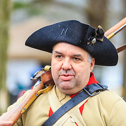 Washington Crossing, PA, USA - December 25, 2015: A reenactor portraying a colonial soldier at the annual Christmas Day reenactment of Washington crossing the Delaware River.