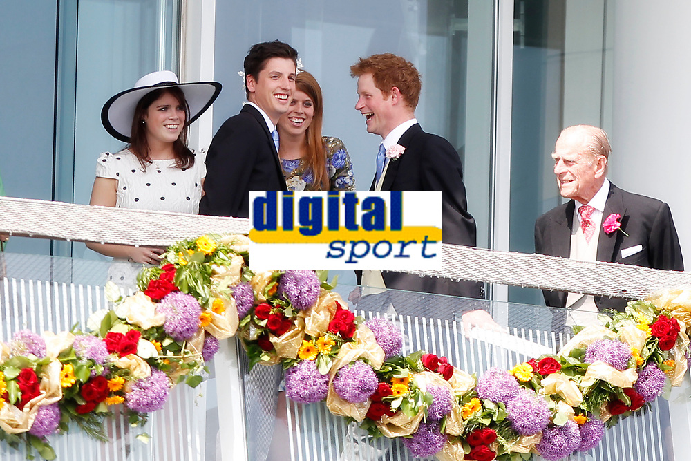 Horse Racing - The Derby <br /> <br /> Prince Harry and a friend chat to Princesses Beatrice and Eugenie at Epsom Racecourse
