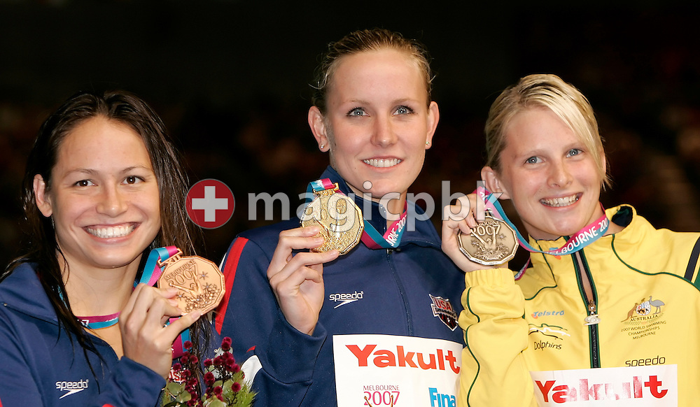(L-R) Third placed Tara Kirk of the USA, winner Jessica Hardy of the USA and second placed Leisel Jones of Australia show their medals after the award ceremony for the women's 50m breaststroke final in the Susie O'Neill pool at the FINA Swimming World Championships in Melbourne, Australia, Sunday 1 April 2007. (Photo by Patrick B. Kraemer / MAGICPBK)