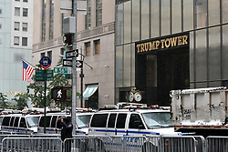 NYPD vans are parked along the sidewalk directly across the street from the Trump Towers as a second day of protest is expected during President Donald Trump's second day stay in New York City since taking office, New York, NY, on August 15, 2017. (Photo by Anthony Behar)