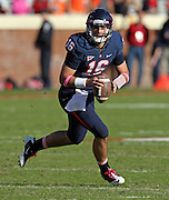 Oct. 22, 2011 - Charlottesville, Virginia - USA; Virginia Cavaliers quarterback Michael Rocco (16) runs with the ball during an NCAA football game against the North Carolina State Wolfpack at the Scott Stadium. NC State defeated Virginia 28-14. (Credit Image: © Andrew Shurtleff/