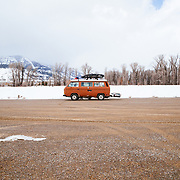 A Volkswagon camper van is parked in the Stilson Parking lot after a day of skiing in winter.