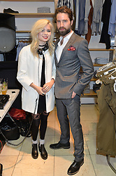 NINA NESBITT and JACK GUINNESS at a party to celebrate the launch of French Connection's #CANTHELPMYSELFIE -The UK's first in-store interactive selfie booths and windows held at French Connection, 249-251 Regent Street, London on 15th April 2014.