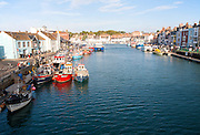 Colourful fishing boats in the harbour at Weymouth, Dorset, England