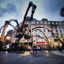 Liverpool city center.  La Princess picks a fight with a digger and then starts to fight with some of the scientists who have been following her around.  One is nearly crushed.