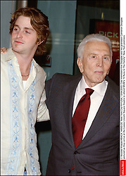 Kirk Douglas Dies At 103 - © Nicolas Khayat/ABACA. 44593-20. New York City-NY-USA, 13/04/2003. Cast members Kirk Douglas and his grandson Cameron Douglas pictured as they arrive at the Loews Lincoln Square theatre to attend MGM's It Runs In The Family New York premiere.