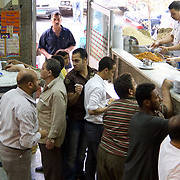 Hungry customers at Koshary Abou Tarek in Downtown Cairo, Egypt.