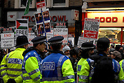London 04/01/09: Protests outside the Israeli Embassy in London UK: Police separated the crowd from the embassy