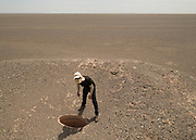 The archeologist looking at a Qanat (traditional well).