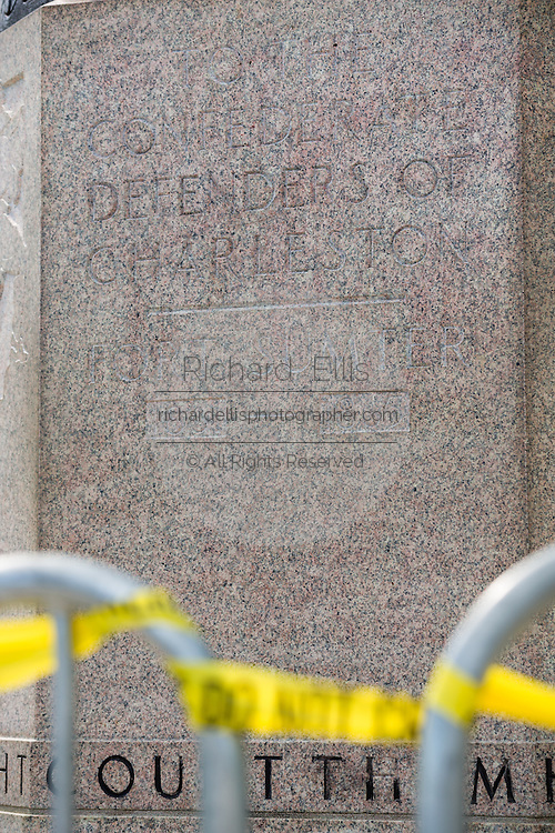 Police crime tape surrounds the base of the Defenders of the Charleston confederate monument after a vandal spray painted Black Lives Matter on the base June 22, 2015 in Charleston, South Carolina. Charleston is the city where the Civil War began and has a conflicted history of balancing honoring soldiers who fought on the wrong side.