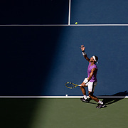 2019 US Open Tennis Tournament- Day Six.  Rafael Nadal of Spain serving against Hyeon Chung of Korea in the Men's Singles round three match on Arthur Ashe Stadium during the 2019 US Open Tennis Tournament at the USTA Billie Jean King National Tennis Center on August 31st, 2019 in Flushing, Queens, New York City.  (Photo by Tim Clayton/Corbis via Getty Images)