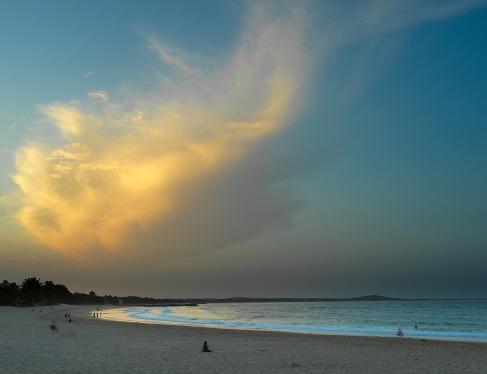 Long exposure and human forms on the waters edge in Noosa Australia during an evening sunset. Licensing and Editions of 17