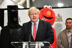 © Licensed to London News Pictures. 13/12/2019. London, UK. British Prime Minister BORIS JOHNSON arrives at the General Election count for the constituency of Uxbridge and South Ruislip. A general election was called for December 12th following a deadlock in Parliament over the UK's decision to leave the EU. Photo credit: Ben Cawthra/LNP