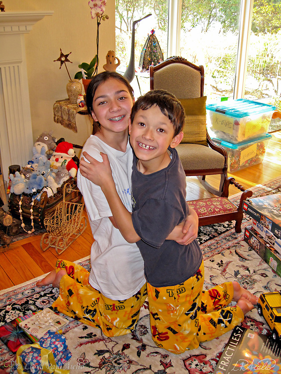 Ashlyn (age 12) and Bryce (age10) give each other a hug while opening gifts on Christmas Day, December 25, 2008