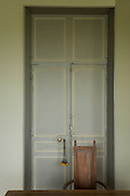 a classic style door with chair and desk