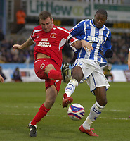 Photo: Matt Bright/Sportsbeat Images.<br /> Brighton & Hove Albion v Carlisle United. Coca Cola League  1. 24/11/2007.<br /> Danny Livesey of Carlisle clears his lines from  Bas Savage of Brighton