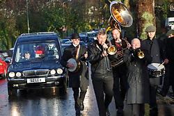 © licensed to London News Pictures. London, UK 03/01/2014. The London Dixieland Jazz Band leading the procession to the funeral of Great Train Robber Ronnie Biggs at Golders Green crematorium in north London. Biggs died on December 18, 2013 aged 84 after famously spent 35 years on the run from prison. Photo credit: Tolga Akmen/LNP