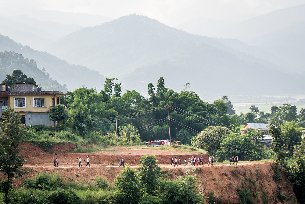 17 September 2018, Kavre district, Nepal: Children are on the way home through the valley, after a day at the Bindabasini Secondary School in Majhigaon, Kavre district, Nepal. The LWF World Service programme has supported the school in establishing running water and the building of toilets, as part of the Post-Earthquake Rehabilitation and Livelihood Recovery Project, of which the school has become one of the beneficiaries and partners.