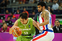 Domen Lorbek of Slovenia vs Eloy Vargas of Dominican Republic during basketball match between National Teams of Slovenia and Dominican Republic in Eight-finals of FIBA Basketball World Cup Spain 2014, on September 6, 2014 in Palau Sant Jordi, Barcelona, Spain. Photo by Tom Luksys  / Sportida.com <br /> ONLY FOR Slovenia, France
