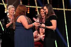 Kirsty Ewen receives her Unsung Hero Award from Jessica Ennis-Hill during the BBC Sports Personality of the Year 2018 at Birmingham Genting Arena.