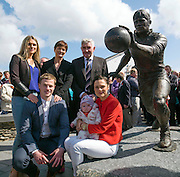 Padraig Og, Fiadh and Neasa with at back, Siun and Maire  O' Se, stands beside the statue to Paidi O'Se after the unveiling by former Kerry trainer Mick O'Dwyer outside Paidi's pub at Ard an Bothair, Ventry, County Kerry on at the weekend. <br /> Picture by Don MacMonagle