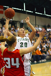 10 January 2009: Holly Harvey shoots a fading jump shot when met by Katie Jarger. The Illinois Wesleyan Titans, ranked #1 in the latest USA Today/ESPN poll, take down the Lady Reds of Carthage and remain undefeated,  2-0 in the CCIW and over all to 12-0. This is the first time in the history of the Lady Titans Basketball they have been ranked #1 The Titans and Lady Reds played in the Shirk Center on the Illinois Wesleyan Campus in Bloomington Illinois.