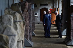 The Prince of Wales (centre) during a visit to the Naval Base, near Cork as part of his tour of the Republic of Ireland.