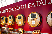 A selection of bulk wines at wholesale prices, available in one or three-liter bottles at the wine shop of Eataly.