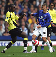 Photo: Andi Thompson.<br />Everton v Manchester City. The Barclays Premiership. 30/09/2006.<br />Manchester City's Ishmael Miller (L) beats Everton Captain Phil Neville (R) to the ball.
