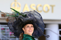 A fashionable racegoer on day three of Royal Ascot at Ascot Racecourse.