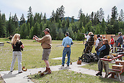 Woman Trap shooting using a convertible wheelhair.