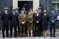 London, UK. 21st January, 2019. Representatives of New Zealand's armed forces serving with British soldiers pose outside 10 Downing Street on the day of a visit by their Prime Minister Jacinda Ardern for talks with Theresa May.