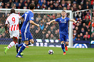 Gary Cahill of Chelsea holds out his arms to signal which way he plays a pass.   Premier league match, Stoke City v Chelsea at the Bet365 Stadium in Stoke on Trent, Staffs on Saturday 18th March 2017.<br /> pic by Andrew Orchard, Andrew Orchard sports photography.