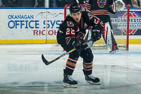 KELOWNA, BC - FEBRUARY 17: Jett Woo #22 of the Calgary Hitmen passes the puck during first period against the Kelowna Rockets at Prospera Place on February 17, 2020 in Kelowna, Canada. Woo was selected in the 2018 NHL entry draft by the Vancouver Canucks. (Photo by Marissa Baecker/Shoot the Breeze)