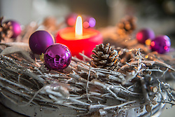 Decorative advent wreath with burning candle, Bavaria, Germany