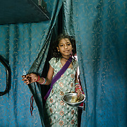 A young girl beggar. Throughout the journey, peddlers pop into the train compartments with all sorts of offerings,  to be bargained for a few rupees.<br /> Inside the Dibrugarh-Kanyakumari Vivek Express, the longest train route in the Indian Subcontinent. It joins Kanyakumari, Tamil Nadu, which is the southernmost tip of mainland India to Dibrugarh in Assam province, near the border with Burma.