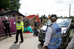 © Licensed to London News Pictures. 12/05/2020. Colne Valley, UK. Police and Bailiffs start the eviction of environmental activists from Extinction Rebellion at the HS2 site in Colne Valley, Buckinghamshire. Activists have chained themselves to the floor in an attempt to prevent the eviction. Photo credit: Marcin Nowak/LNP