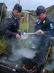 Sunday 7th May 2017 East Fortune:  Wartime Experience at the National Museum of Flight, East Fortune.  Catering core prepare food over a fire.  Members of the WW2 German Forces Living History Society.<br /> <br /> (c) Andrew Wilson | Edinburgh Elite media