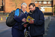 AFC Wimbledon assistant manager Nick Daws signing autographs during the EFL Sky Bet League 1 match between AFC Wimbledon and Doncaster Rovers at the Cherry Red Records Stadium, Kingston, England on 14 December 2019.