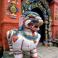 NEPAL, Kathmandu. Mythical lion (Singha) guards temple door at Hanuman Dhoka Temple, Durbar Square.