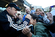 """Actor Kevin James signs the forehead with a sharpie of mega fan, Rose Atkinson, 9, during the Colorado premiere of """"Here Comes the Boom"""" at the United Artists Colorado Center 9 on Oct. 4. Other celebrities who appeared at the Red Carpet event included renowned mixed-martial arts fighter Bas Rutten and MMA fighters Nate Marquardt, Michelle Blalock and Jason """"The Dragon"""" Lee."""