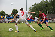Yasin Kurt on the attack Northern Cyprus. Karpatalya (RED) beat Northern Cyprus (WHITE) 3 -2 in penalties during the Conifa Paddy Power World Football Cup finals on the 9th June 2018 at Queen Elizabeth II Stadium in Enfield Town in the United Kingdom. Team mates from the Turkish Republic of Northern Cyprus  take on the Hungarians in Ukraine for the CONIFA World Football Cup final. CONIFA is an international football tournament organised by CONIFA, an umbrella association for states, minorities, stateless peoples and regions unaffiliated with FIFA. (photo by Sam Mellish / In Pictures via Getty Images)Karpatalya (RED) beat Northern Cyprus (WHITE) 3 -2 in penalties during the Conifa Paddy Power World Football Cup finals on the 9th June 2018 at Queen Elizabeth II Stadium in Enfield Town in the United Kingdom. Team mates from the Turkish Republic of Northern Cyprus  take on the Hungarians in Ukraine for the CONIFA World Football Cup final. CONIFA is an international football tournament organised by CONIFA, an umbrella association for states, minorities, stateless peoples and regions unaffiliated with FIFA. (photo by Sam Mellish / In Pictures via Getty Images)