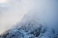 Mountain peak emerges from cloud, Lofoten Islands, Norway