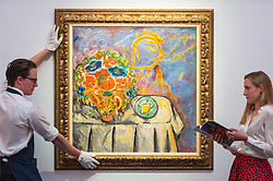 "© Licensed to London News Pictures. 31/05/2019. LONDON, UK. A technician and staff member with ""Still Life"" by Mikhail Fedorovich Larionov (Est. GBP 1-1.5m) at a preview of works from the upcoming sale of Russian Pictures, Works of Art, Fabergé & Icons Sales at Sotheby's, New Bond Street, on 4 June 2019.  Photo credit: Stephen Chung/LNP"