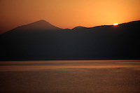 Sunrise over Mount Golema (2179m) and Mount Pelister (2600m ) in the Pelister National Park. View from Stenje village across Lake Macro Prespa. Shadow rays cast over mountain.<br /> Stenje region, Lake Macro Prespa (850m) <br /> Galicica National Park, Macedonia, June 2009<br /> Mission: Macedonia, Lake Macro Prespa /  Lake Ohrid, Transnational Park<br /> David Maitland / Wild Wonders of Europe